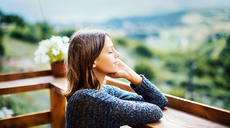 young woman with persistent illness relaxing outside