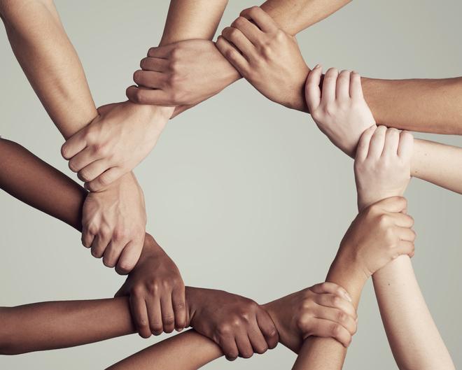 diversity holding hands
