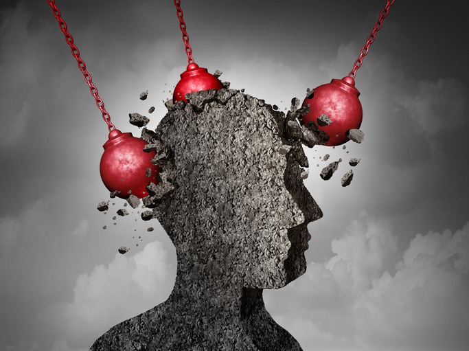 Painful headache concept; human head being hit by a wrecking ball